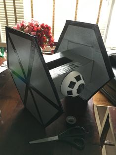 Star Wars Valentine's Box for Bo's class!  Made out of spray paints card board boxes, duck tape, and a small styrofoam ball cut in half on the front and back.  All accents are duck tape as well, the little ones work best!