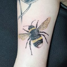 This Furry Bee Tattoo. If you want a detailed tattoo, this one is perfect for you.
