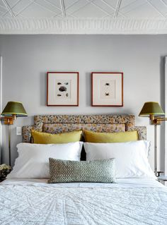 bedroom; upholstered headboard, wall lamps, pattern mix