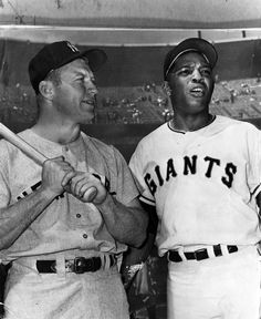 In this photo, New York Yankees center fielder Mickey Mantle and San Francisco Giants center fielder Willie Mays chat before Game 1 of the 1962 World Series. It was the first World Series game ever played at Candlestick Park in San Francisco.