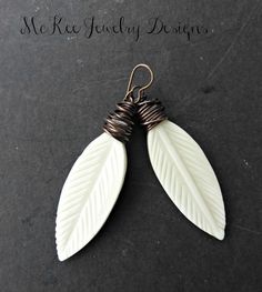 Feather bone earrings. With copper wire wrapping and ear wires. Simple, lightweight.