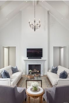 Vaulted Ceilings, Custom Millwork Fireplace and Circa Lighting Chandeliers in Great Room at CDN.