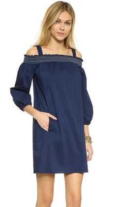 A casual Shoshanna dress with slim shoulder straps and a ruched elastic neckline. Long blouson sleeves. On-seam pockets. Unlined.