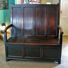 A George III Welsh oak Settle, with good colour, probably very early 19th century in date.