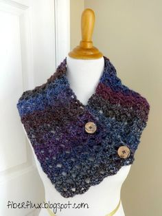 """The Estelle Button Cowl is worked up in chunky lace and is a lovely addition to a wintry wardrobe. Double """"V"""" stitches make a pretty, easy, and lacy cowl!  Estelle Button Cowl By Jennifer Dickerson"""