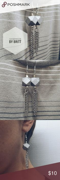 ** HANDMADE ** Silver Geometric Chain Earrings This is a pair of beautiful silver geometric chain earrings handmade by me!!   Geometric shape made of wood and colored silver, complete with chain tassels!   I made multiple sets of these & 12 pairs are available.   ** Please no low offers. My jewelry is handmade & is priced in line with material costs & the time it takes for me to design & create.   That means, you have an entirely unique piece of jewelry made with love!!! Handmade Jewelry…