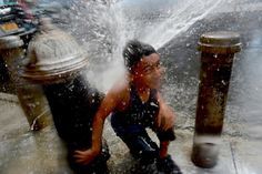 Temperatures soared to the high 90s on July 6, 2016. Ashfak Arab, a 6-year-old Ditmas Park resident, originally from Bangladesh is pictured playing in hydrant spray on Marlborough Road.