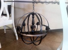 Orb Chandelier DIY - awesome!  Whole thing is $25.