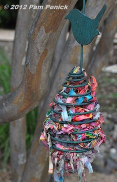 Hanging nesting material for the birds adds even more color to the garden.