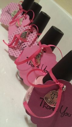 we can get a bunch of pink nail polishes and put thank you notes on them but on animal print paper. we can give them to the ladies