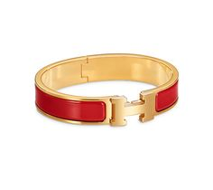 "Hermès -- Hermes narrow bracelet in enamel Gold plated hardware, 2.5"" diameter, 8"" circumference, 0.5"" wide.  Color : amaranth red Ref. H700001F 94GM $600.00"