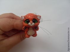 polymer clay kitty cat charm reminds me if puss in boot from shrek 2! Just add some boots and a hat!