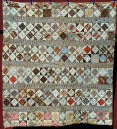 Diamond in a Square, 1860-80, 60x62, provenance, Maine. Gladys Hasty Carroll estate. Shades of brown, tan, madders, pinks, grays, etc. fill the double diamond in squares blocks, and the wide sashing is gray and fawn cobblestone print. Yet, more British influence. The batting is rather thick, and the quilt is tied with 6-ply gray yarn. The backing is a small scale tan stripe with red that has been replaced on two edges with a much more modern large scale c. 1920 fabric.