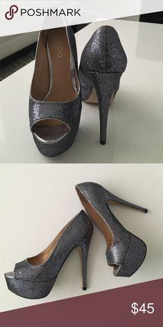Sparkly high heels by Aldo Sparkly deep grey heels. Worn twice. Size 6.5. The heel is crazy high. Shoes Heels