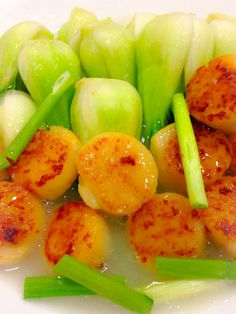 Ginger, garlic, green onion fried scallop with bok choy More