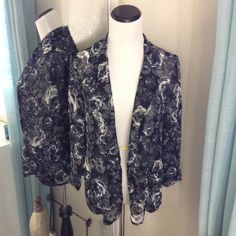 Sheer Chiffon B&W Floral Blazer Beautiful sheer chiffon black and white floral blazer. Lightweight and elegant. I took the tags off, then never wore. NWT. Material Girl Jackets & Coats Blazers