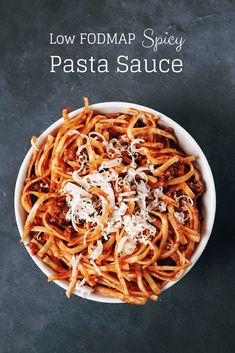 Low FODMAP spicy pasta sauce on spaghetti in bowl with text overlay: Low FODMAP Spicy Pasta Sauce