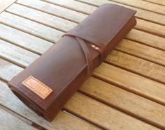 A handmade & hand stitched knife roll, made from an excellent quality oil tanned bullhide leather and lined with pig skin.
