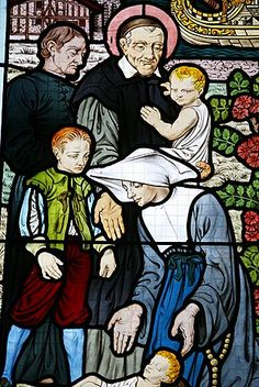 Stained glass depicting St. Vincent de Paul, founder of the Daughters of Charity congregation, at Saint-HonorŽ d'Eylau church, Paris, Ile de France, France, Europe
