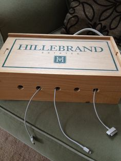 I used an old wood wine box to create a charging station for all the iPod/iPhone/iPads, I think the wife is going to cover it in fabric or something this week.