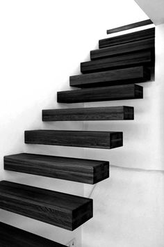 Escalera realizada en madera oscura tipo wengué. #Wood #Stairs: