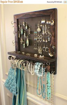 *****This is a MADE TO ORDER listing. You will receive a jewelry organizer the same as the one pictured above but this one already has a home.***** This listing is for a wall mounted jewelry organizer just like the one pictured above. It is stained a beautiful mixture of ebony and dark