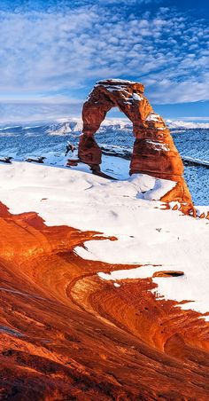 """""""Delicate White"""" Arch in snow. Photographer Gleb Tarro says,  """"This is a rare sight as snow doesnt usually stay long in this part of the world. I was lucky few years ago to capture this stunning picture of white over red and blue"""" [Arches National Park, Utah]"""