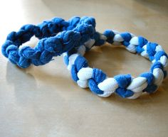 Weaving bracelets is a fun way to make use of old t-shirts, just cut the shirts into strips and use it as yarn.  Instructables has a lot of great tutorials on...
