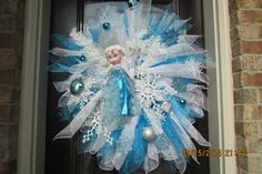 This beautiful hand-crafted Frozen Theme deco mesh wreath features Elsa, the Snow Queen from Disneys Frozen. It comes adorned with icicles ,