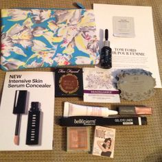 High End Make Up Galore! Ipsy bag,Tom ford perfume sample, tarte tanning face towelette, Starlooks lip mini in cuddle, Tokyomilk dark tainted love mini, clarines spf 40 mini, too faced matte bronzer in medium/deep, the balm mini eyeshadow, pixi mini dual eyeshadow, cool way oil treatment for hair, full sided eyeliner in ebony. All unused except the balm swatched. Update: Bobbi Brown concealer no longer available. Too Faced Makeup