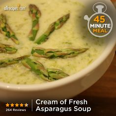 "Cream of Fresh Asparagus Soup II | ""Put that fresh spring asparagus to good use in this creamy soup! Asparagus and onion are cooked in chicken broth, pureed, and combined with milk, sour cream, and a little fresh lemon juice."""