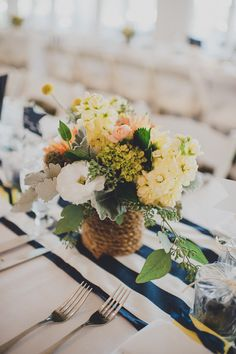 nautical floral arrangement wrapped in rope.  http://www.weddingchicks.com/2013/12/05/navy-and-yellow-nautical-wedding/