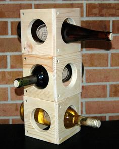 """Handcrafted from my Wood Shop to your Home! This is 1 Square Natural Pine Solid Wood Storage Rack, with holes for bottles. Use them for Wine or Cooking Supplies, etc. Stack them anyway you like, and purchase as many as you like. Fully Assembled This is 5 1/2"""" Square, and Weighs 2 Lbs ( fits under most cabinets as counter top model also)- Included: Hardware and Assembly Instructions, 9 Pc Solid Pine, and Screws ~Hand Picked Quality lumber, sanded on all sides, Natural Pine will have some…"""