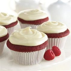 Top Red Velvet Cupcakes with raspberries and blueberries for a perfect red, white and blue treat. #recipe