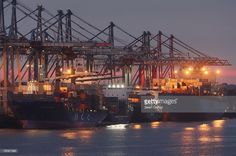 Container ships dock among cranes at the main container port August 13, 2007 in Hamburg, Germany. Northern Germany, with its busy ports of Hamburg, Bremerhaven and Kiel, is a hub of international shipping. Hamburg is among Europe's largest ports.