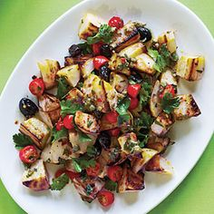 Grill Yukon gold potato halves and combine with a mixture of tomatoes, capers, oregano, olives, and anchovies for a Mediterranean-style potato side dish.