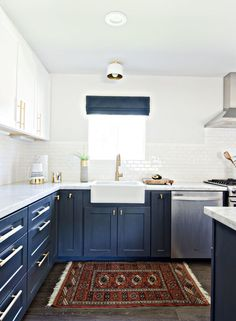 two toned kitchen with white upper cabinets and navy lower cabinets // studio-mcgee.com