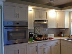 Laura- After. BM White Dove in shaker style doors, microwave cabinet with pocket doors #GreenKitchensUSA