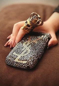 YSL phone case is sparkly & amazing but that skull king ring is the bomb. Uber cool! !