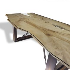 """Book-matched curly maple made from three natural edge slabs made to intentionally create voids covered by custom edged glass top that follows natural live edge - 42""""x 92"""" Base: Recycled from metal girders with center supports are structural turnbuckles and 3/4"""" threaded rods. Base is finished with a torch burned custom coating"""