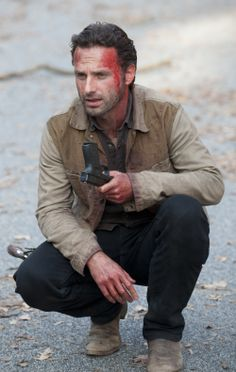 "Rick Grimes (Andrew Lincoln)...the scruffy face, the boots, the ""i just kicked serious ass"" look...yea. :)"