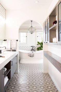 beautiful modern eclectic bathroom arched doorway bathtub tile