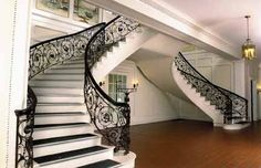 SAMUEL YELLIN (American 1885-1940) Wrought iron staircase railings from Bayberry Land. Circa 1919, from the Grand Staircase, the four curved 'stairway' sections and two straight 'landing' sections with scrolls throughout each centered by a different medallion featuring various flowers and animals. #FreemansAuction