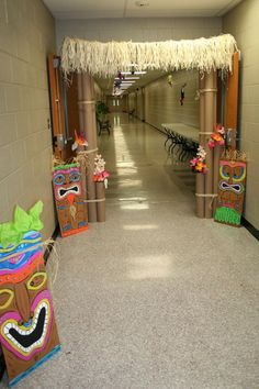carpet tubes, tikis out of cardboard, straw grass top awning....perfect for entry back drop.  .