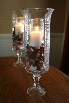 I made these hurricane lamps from glass candleholders and vases purchased from the dollar tree for centerpieces for John Michael's rehearsal dinner.  Use E6000 glue to put the pieces together.  Let the adhesive cure for 24 hours.  LED candles work best.  These are comparable to the hurricane lamps at William-Sonoma , but they cost only a couple of dollars to make