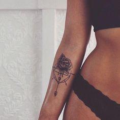 Rose compass arm tattoo