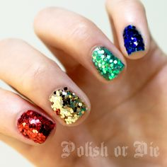 Mini hexagon glitter holiday bling nails in green, blue, gold, and red - looks like ornaments!