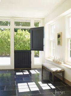black, charcoal gray beadboard dutch door in modern home, Exquisit, black slate tiles, bench in white entry foyer