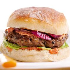 A delicious sauce made of sweet peppers, almonds, brown sugar, and garlic tops this mouthwatering burger. More crowd pleasing burger recipes: http://www.bhg.com/recipes/burgers/grilled-burger-ideas/?socsrc=bhgpin081113westcoastburger=16