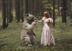 Russian photographer Katerina Plotnikova has created these Wonderland-like images using real animals interacting with real people.